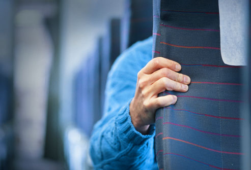 getty_rf_photo_of_man_gripping_airplane_seat